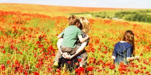family in field of flowers