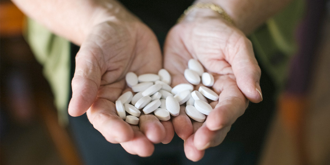 holding pills in cupped hands