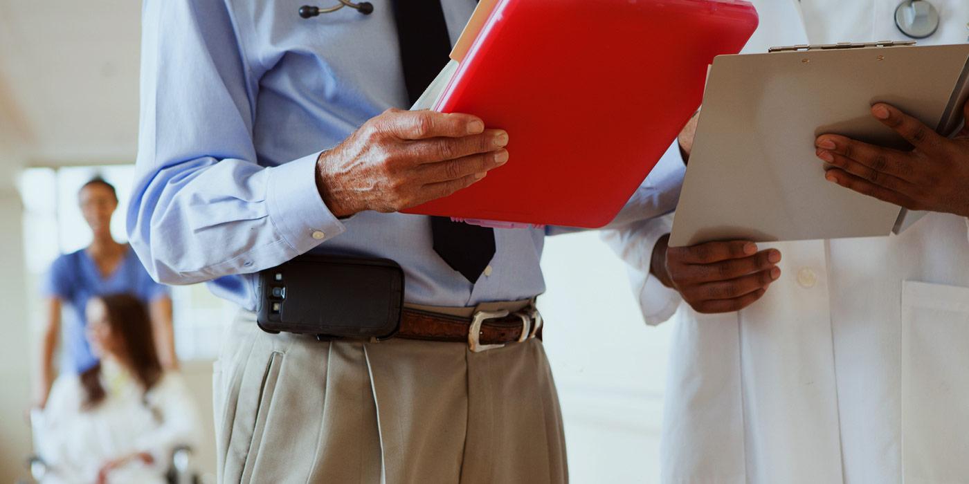 doctors reviewing patient records