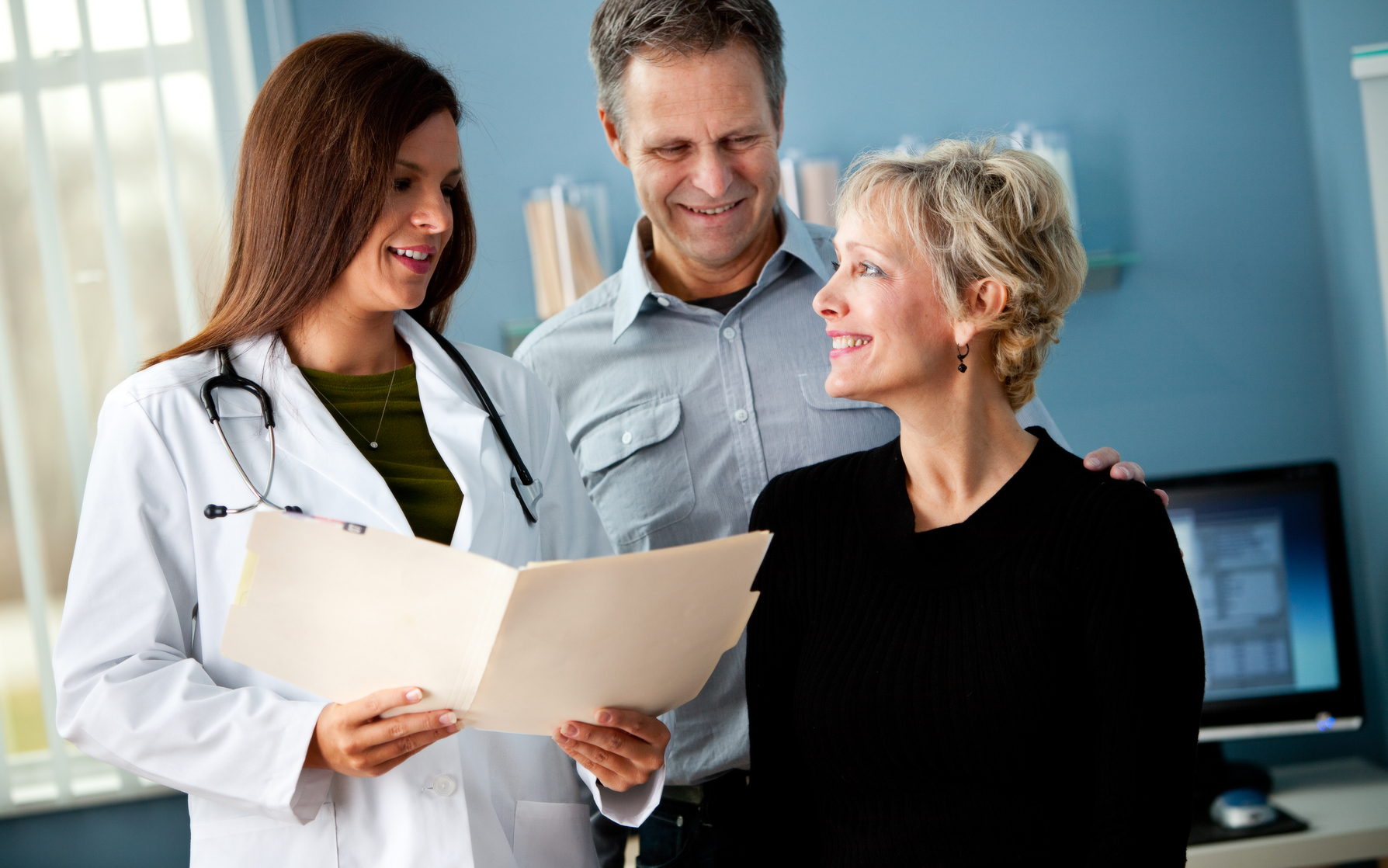 Doctor giving woman positive results