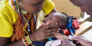 A BABY RECEIVES A VACCINE AT A MEDICAL CLINIC IN KENYA