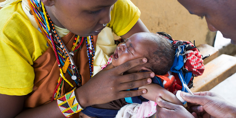 A BABY RECEIVES A VACCINE AT A MEDICAL CLINIC IN KENYA. MOST HEALTH CARE SYSTEMS IN LOW- AND MIDDLE-INCOME COUNTRIES WERE SET UP TO FIGHT INFECTIOUS DISEASE RATHER THAN NONCOMMUNICABLE DISEASES SUCH AS CANCER
