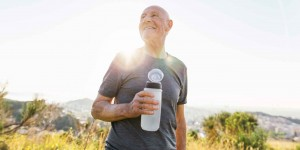 Man holding water bottle outside