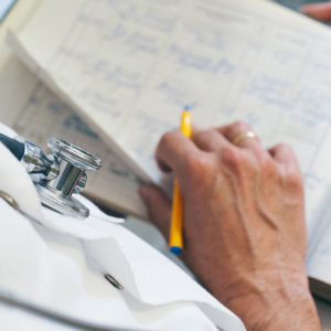 doctor holding pencil and notebook