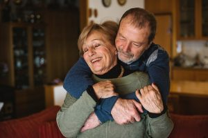 husband hugging wife