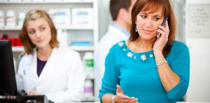 Pharmacy patient on cell phone