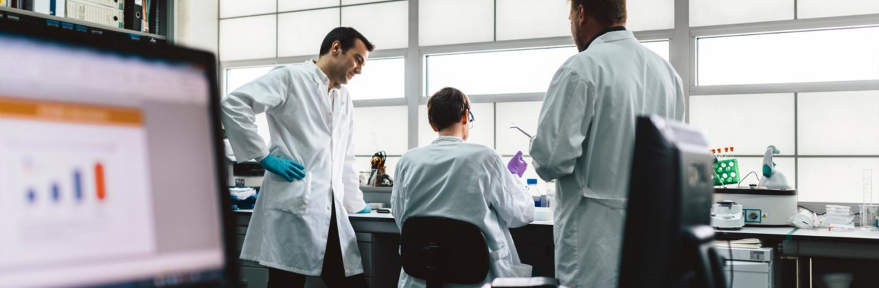 Researchers working in lab