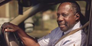 African American man driving car