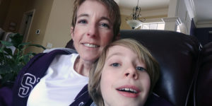 AMY WOLVERTON AND HER NEPHEW DYLAN TAKE A SELFIE TOGETHER.
