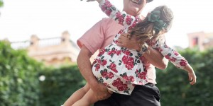 Man lifting young girl