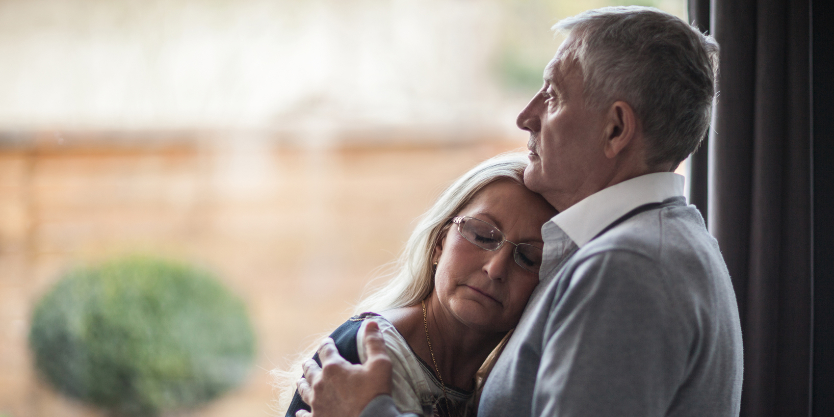 wife resting head on husband's chest