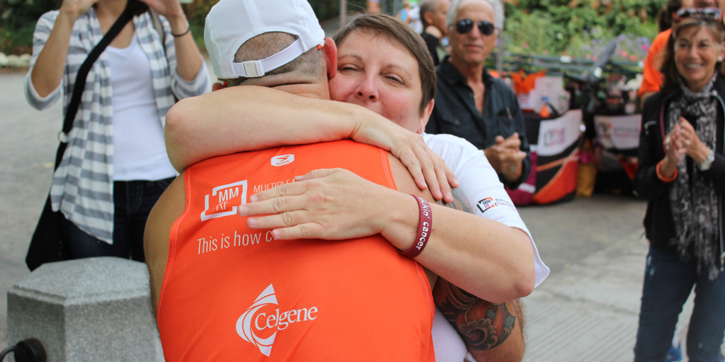 Myeloma patient Pam gives Eric Gelber a hug