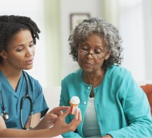 Nurse and patient looking at medicine