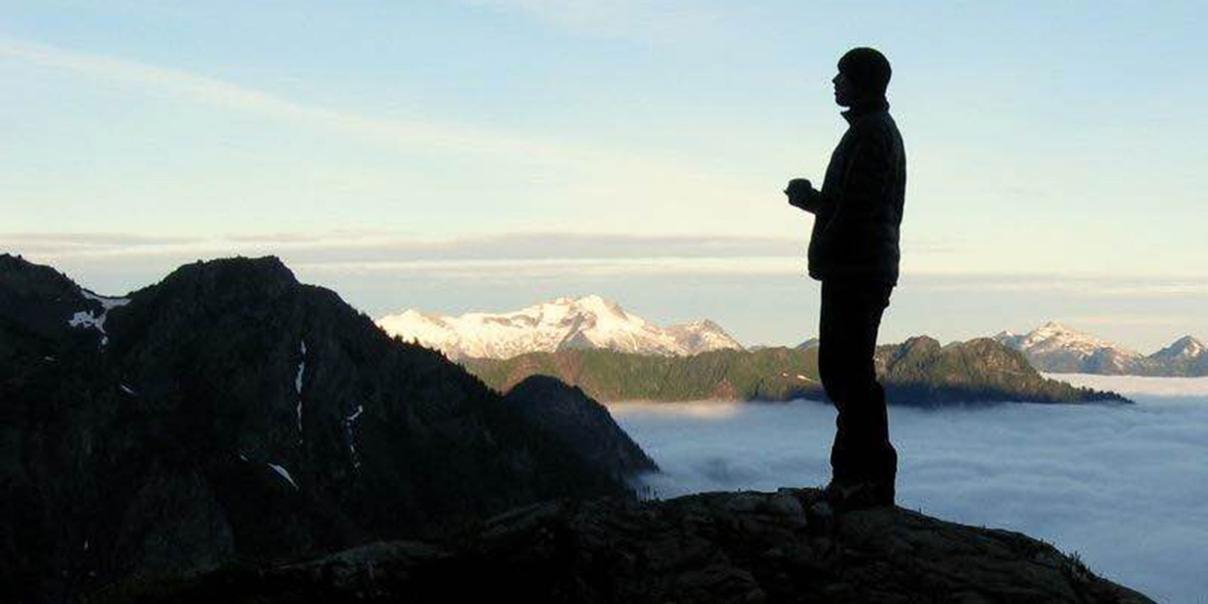 Man standing on mountaintop
