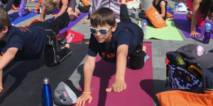 AS HER KIDS HAVE GROWN, THEY BETTER UNDERSTAND WHAT THEIR MOTHER HAS GONE THROUGH. THEY JOIN HER IN VOLUNTEER WORK WITH LIVING BEYOND BREAST CANCER, PARTICIPATING IN EVENTS SUCH AS THE ANNUAL YOGA FUNDRAISER.